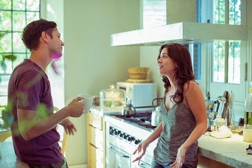 caucasian couple having discussion in their kitchen